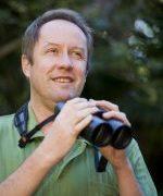 Image of Professor Hugh Possingham with binoculars